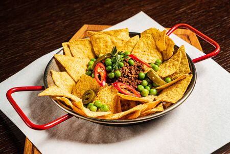 Spicy chili made with tomato, beans, and ground beef with chips Stock Photo