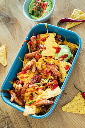 Taco with avocado dip and corn chips Stock Photo