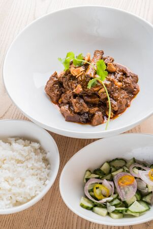 Beef with rice on marble bowl