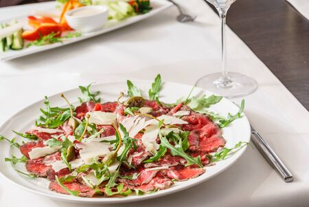 Beef carpaccio on white plate