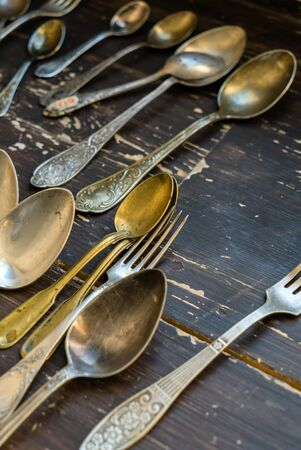 Vintage spoons and forks on wooden table Stock fotó