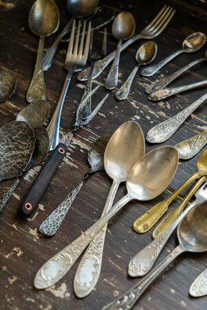 Vintage forks and spoons on wooden table Stock fotó