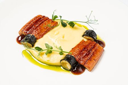 eel with mashed potatoes and vegetables