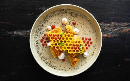 Honey cake with meringue and berries 스톡 콘텐츠