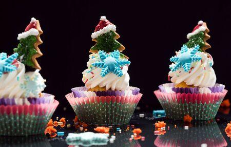 Christmas cupcakes on black Stock Photo