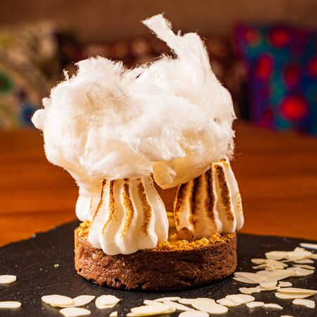 mango tart with meringue and cotton candy
