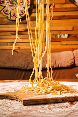 fresh laghman pasta on the wooden board Фото со стока