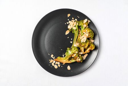 roasted broccoli with almond on the black background Stock fotó