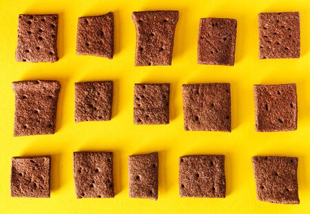 buckwheat and cacao crackers on the yellow background Stock fotó