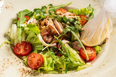 seafood salad with lemon, closeup