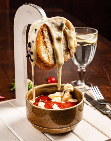 tomato soup with toasts and cheese