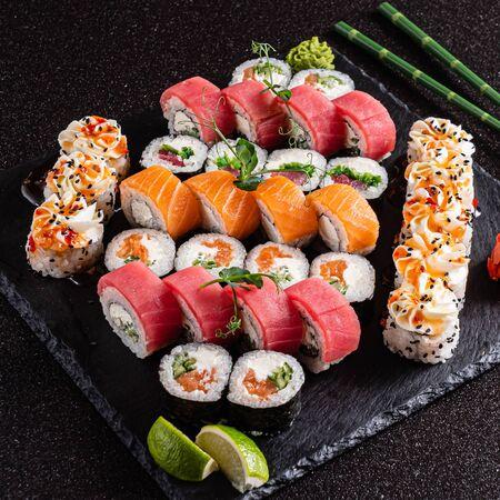fresh and tasty sushi on the black background