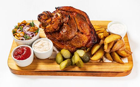Fresh roasted pork knuckle with baked potatoes