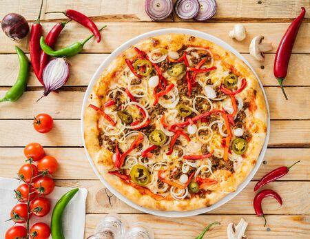tasty pizza on the wooden background Stockfoto