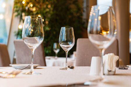 Served dinner table in a restaurant. Restaurant interior