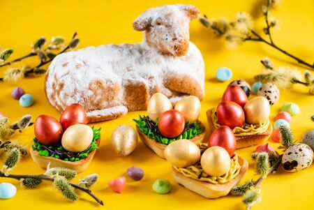 Easter pastries on the yellow background