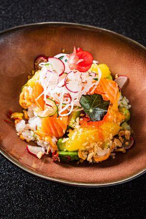poke bowl with salmon and fruits Standard-Bild