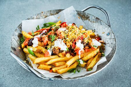 french fries with minced meat, beans and vegetables Stock Photo