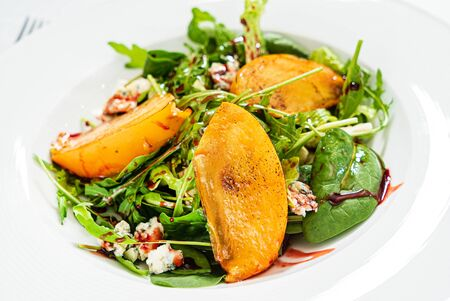 winter salad with persimmon adn nuts