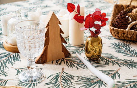 Christmas table with cones and candles