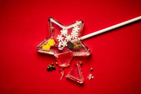 Christmas lollipop on the red background Standard-Bild