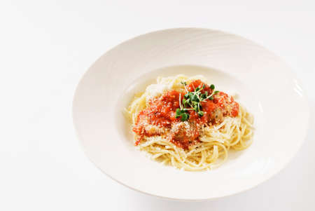 spaghetti with meatballs on the white plate