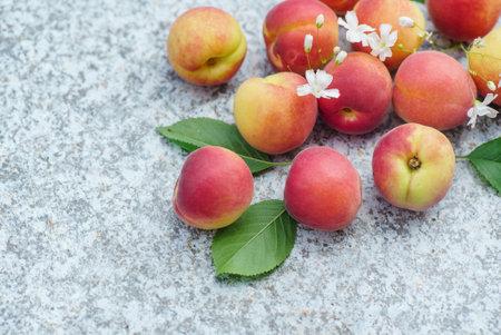 fresh organic peaches with flowers