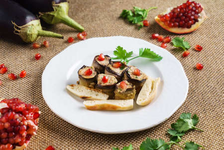 eggplant rolls with pomegranate seeds