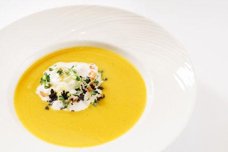 vegetable cream soup on white