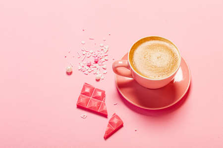 cup of coffee and pink chocolate