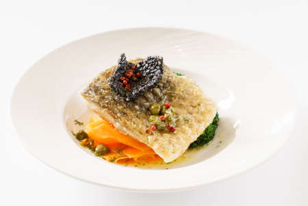 fish with vegetables on the white background 免版税图像