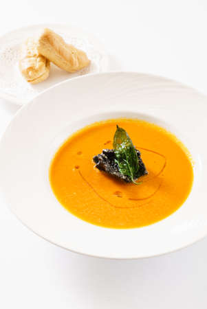 pumpkin cream soup on white