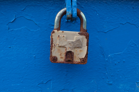 Old padlock relating to the blue wall.