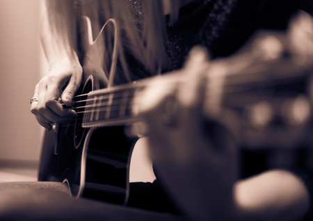 Rockman Guitar Player > Musician playing a guitar, feminine hands Stock Photo - 81855280