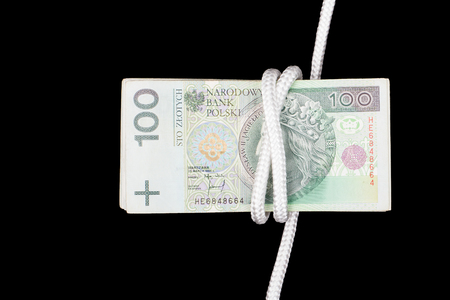 Polish money,concept of rope. Polish banknotes & white rope. 100 PLN