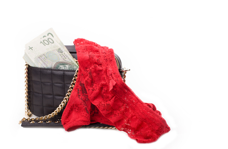 Prostitution - purse with money. Money from practicing prostitution. Stock Photo