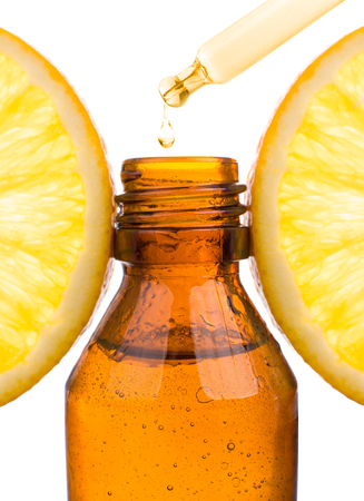 Essential oil with orange - vitamin C. Natural remedies, drop vitamin C - pipette Foto de archivo