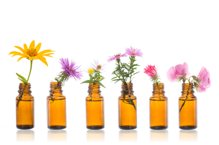 Natural remedies, bottle -  bach Bottles of essential oil with herbs holy flower. Archivio Fotografico - 112514710