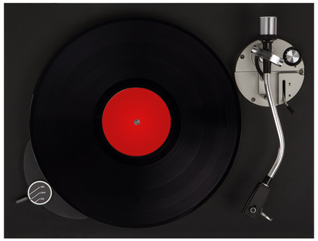 Turntable playing vinyl close up with needle on the record. Record player with vinyl record.