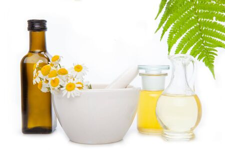 Herbs for alternative medicine, natural cosmetics. Essential oil, with flowers and natural herbs.