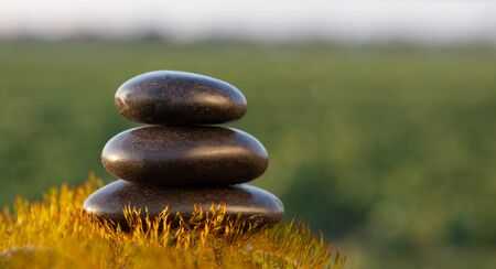 Stack of zen stones on nature background.