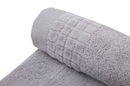 Rolled towel, fabric detail. Cute towel for wiping the body Standard-Bild