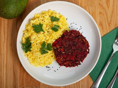 A healthy beetroot burge - photo flat lay. Vegetable dish with rice and turmeric.