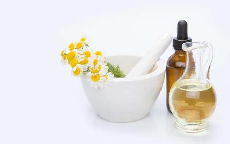 Alternative medicine herb, mortar, on white background.