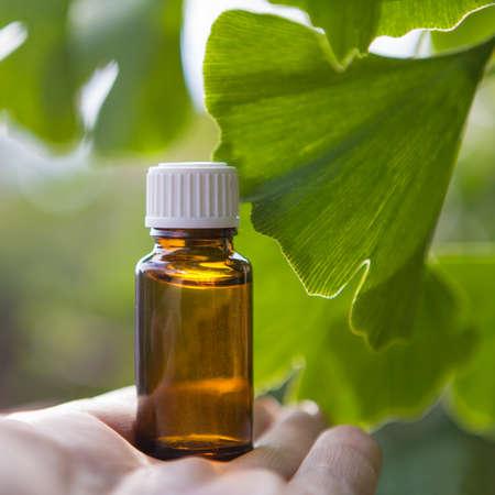 Ginkgo biloba leaves and medicine bottles.