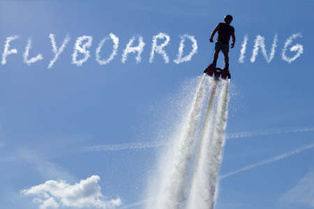 Man enjoy flyboarding in guam resort. Solo guy airboarding or flyboarding vertical.