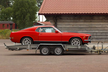 Car Service Transportation Concept. Old classic sport red car transported