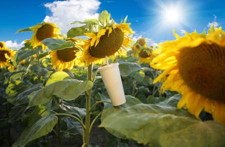 A mug in sunflowers - a fun and joyful concept.