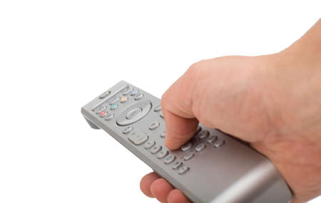 Male hand changing channel with remote control isolated. Hand pressing silver remote control isolated on white background.