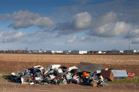 Poznan, Poland - April 02, 2021: Illegal landfill outskirts of town. Criminal environmental pollution of wildlife.